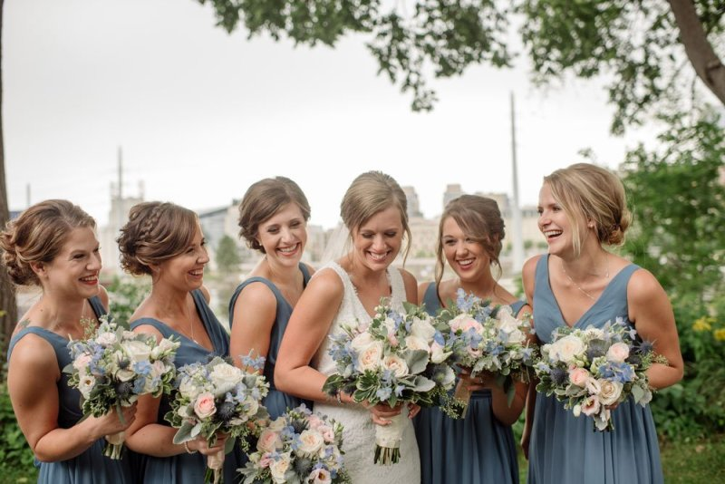 bridesmaids laughing at MEC wedding Minneapolis