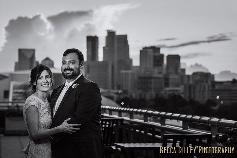 couple with skyline Minneapolis Campus Club Wedding