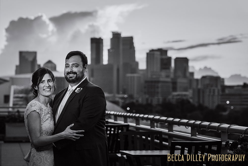 couple with skyline Minneapolis Campus Club Wedding
