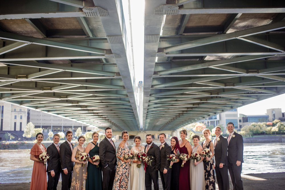 2017 favorite photos best Minneapolis photographer wedding party with nicollet bridge