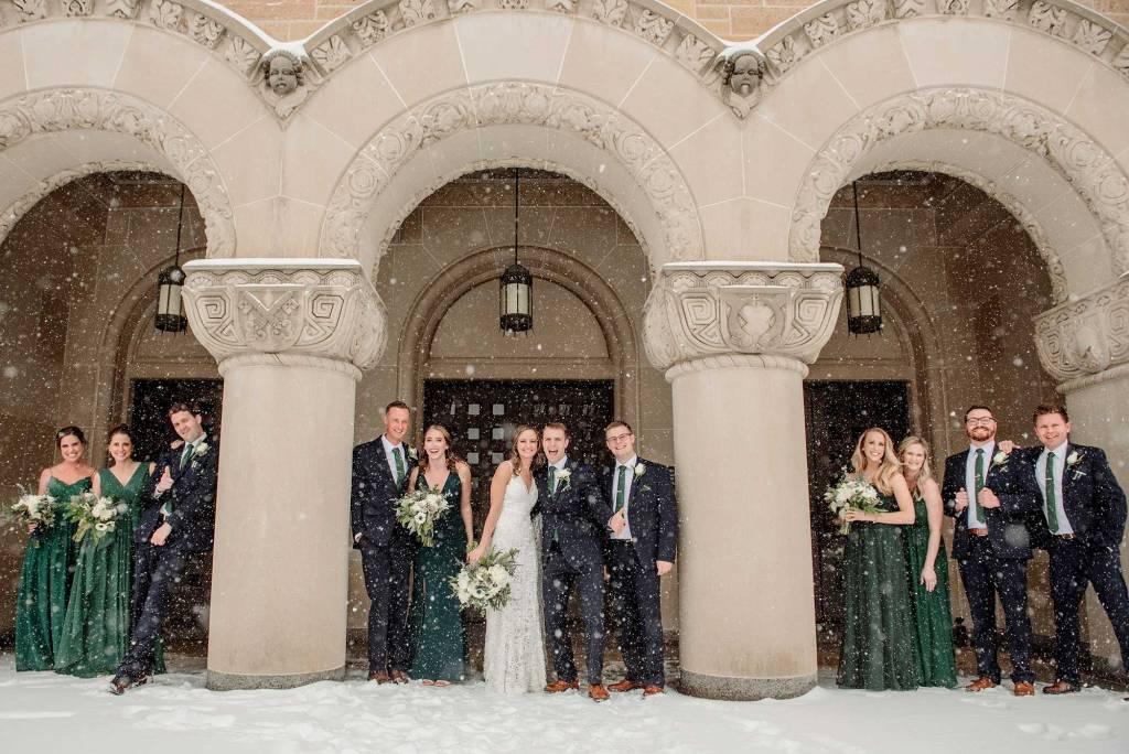 best minneapolis winter wedding large group in snowsstorm