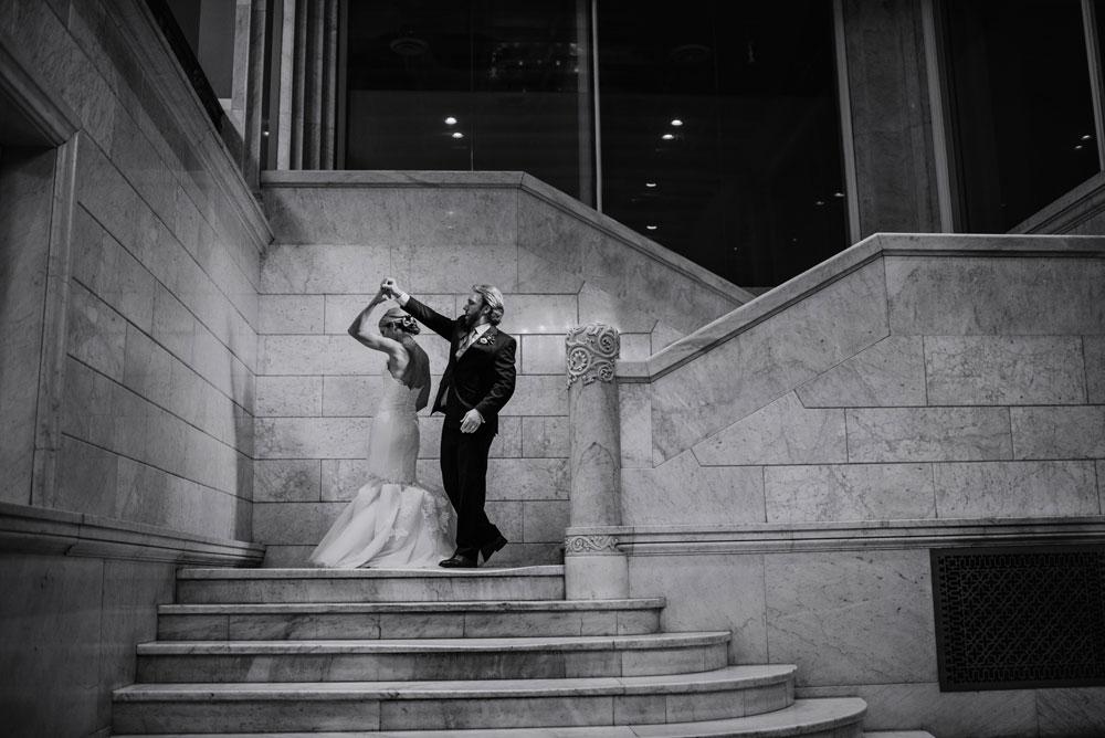 bride and groom on stairs at Lumber Exchange Wedding