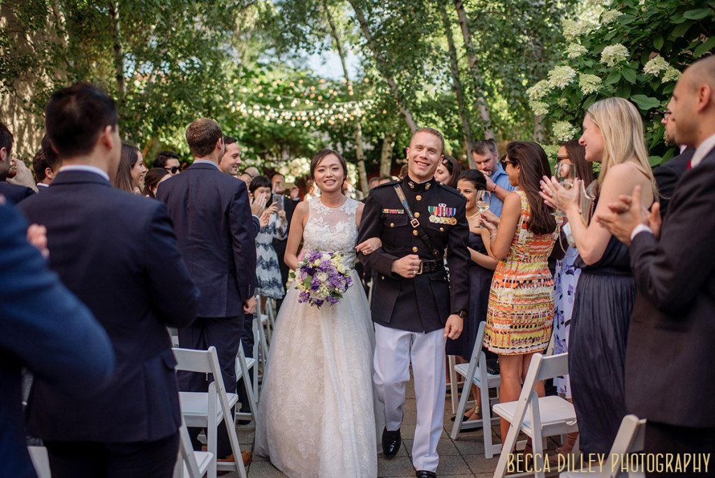 couple walks down aisle after Van Dusen Mansion Wedding ceremony