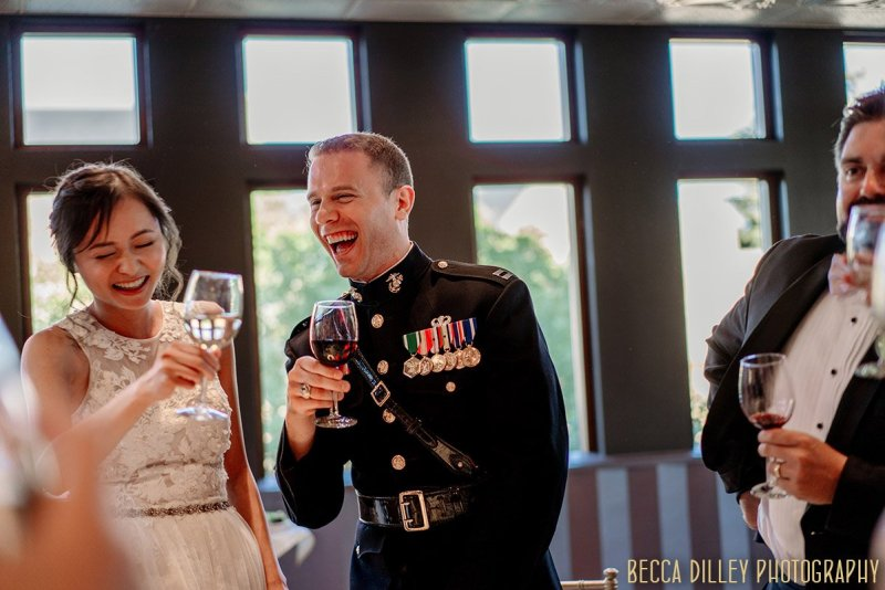bride and groom laugh during toasts at Van Dusen Mansion Wedding Minneapolis