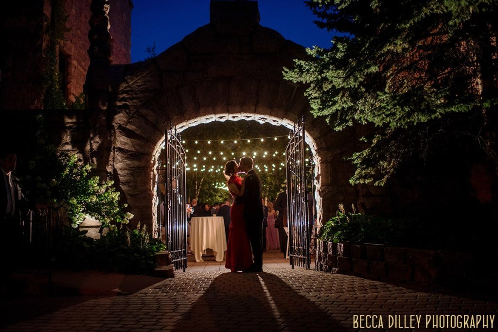 dramatic portrait of bride and groom at night outside van dusen mansion