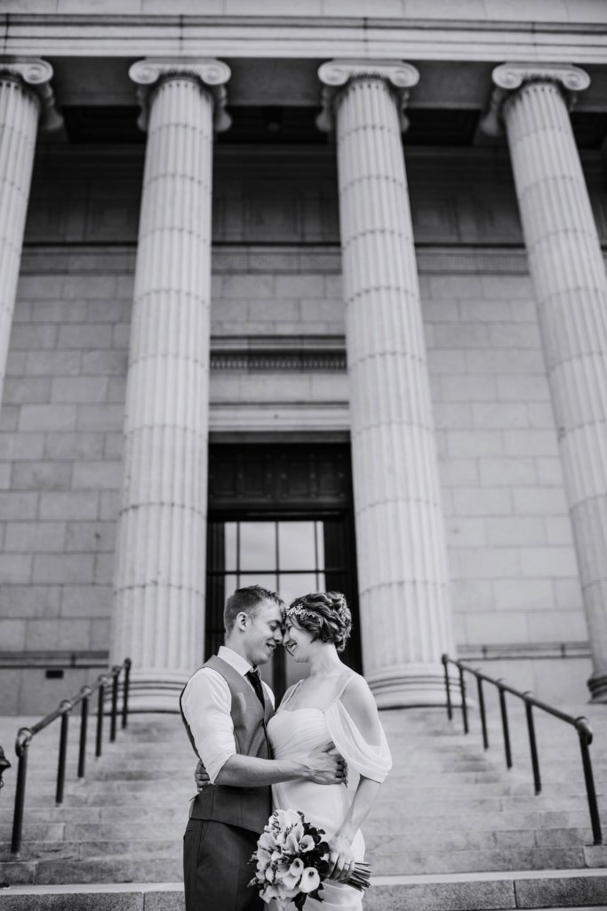 couple outside Minneapolis Institute of Art for wedding black and white portrait