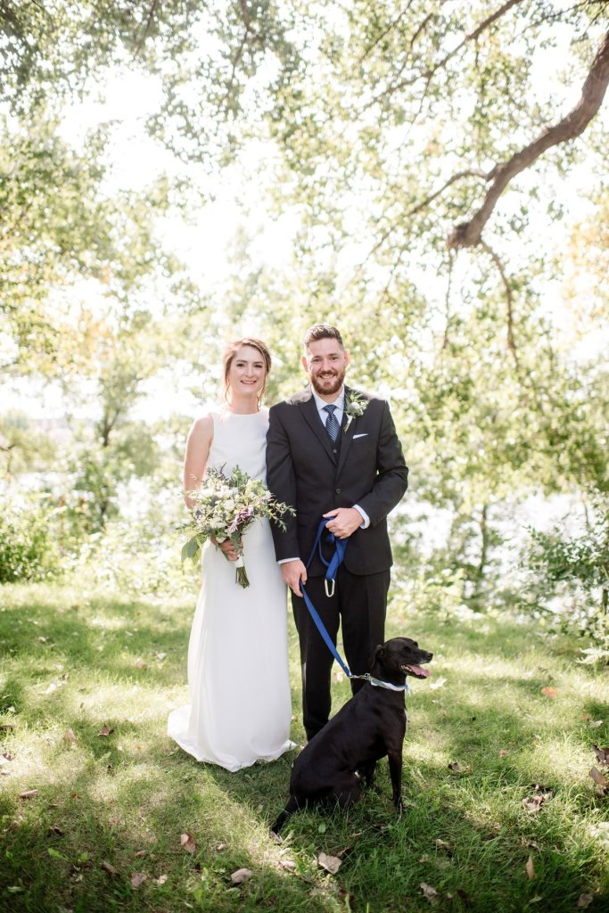 bride and groom and their dog in minneapolis park before wedding sunny summer day
