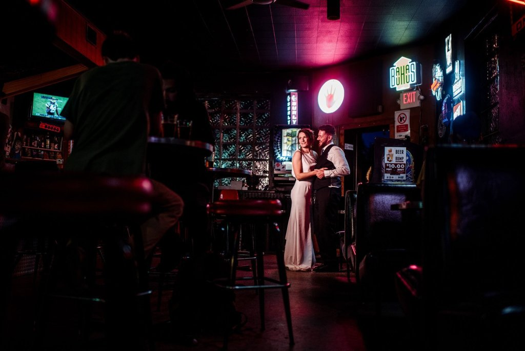 bride and groom in grumpys dive bar in northeast minneapolis during wedding