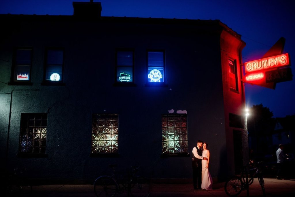 couple outside of grumpys dive bar wedding