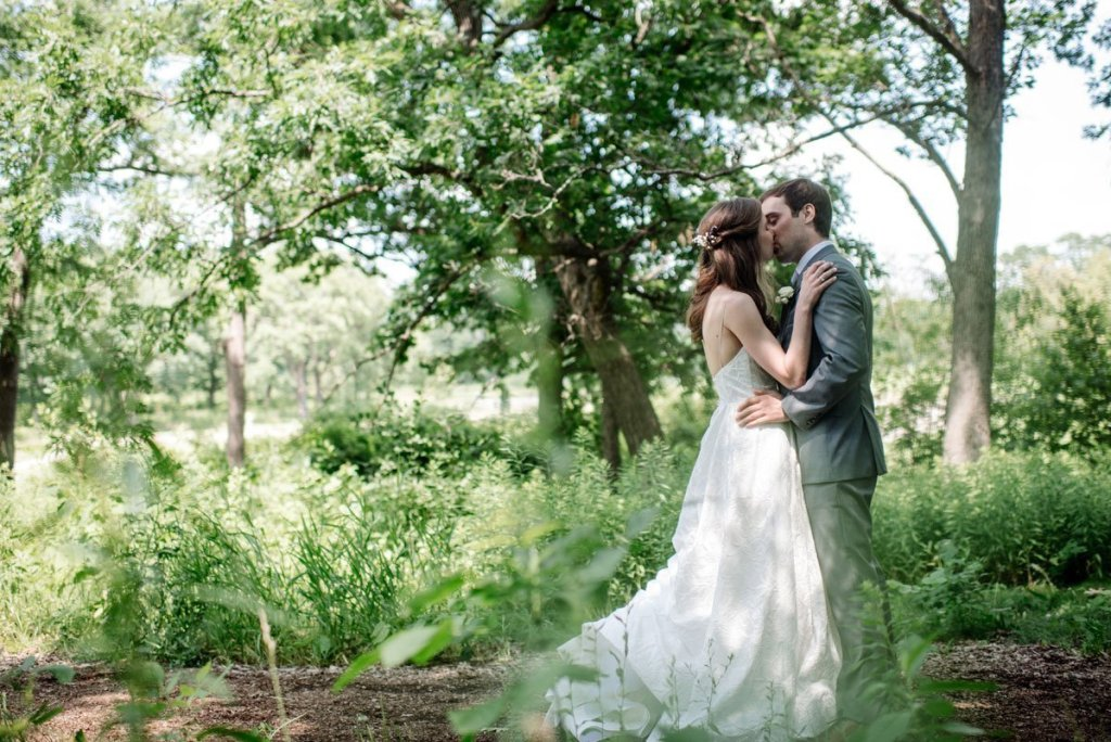 couple embrace in woods of silverwood park wedding mn