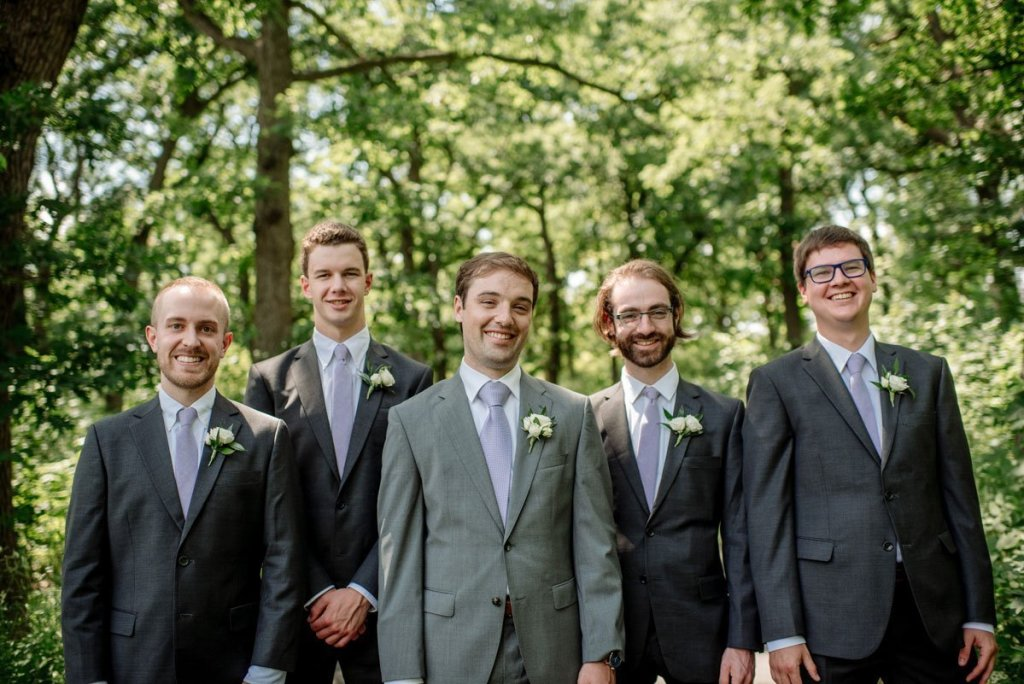 groomsmen laugh at silverwood park wedding mn