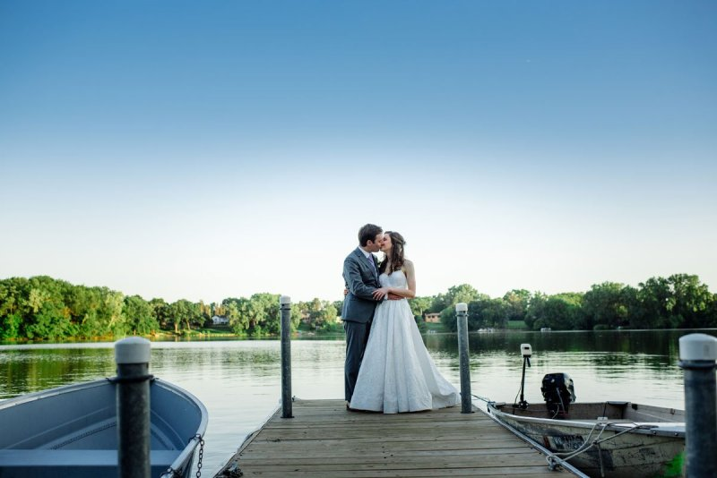 couple on dock at silverwood park wedding mn