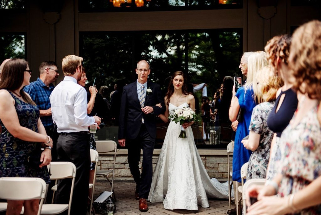 bride and father walk down aisle at silverwood park wedding mn