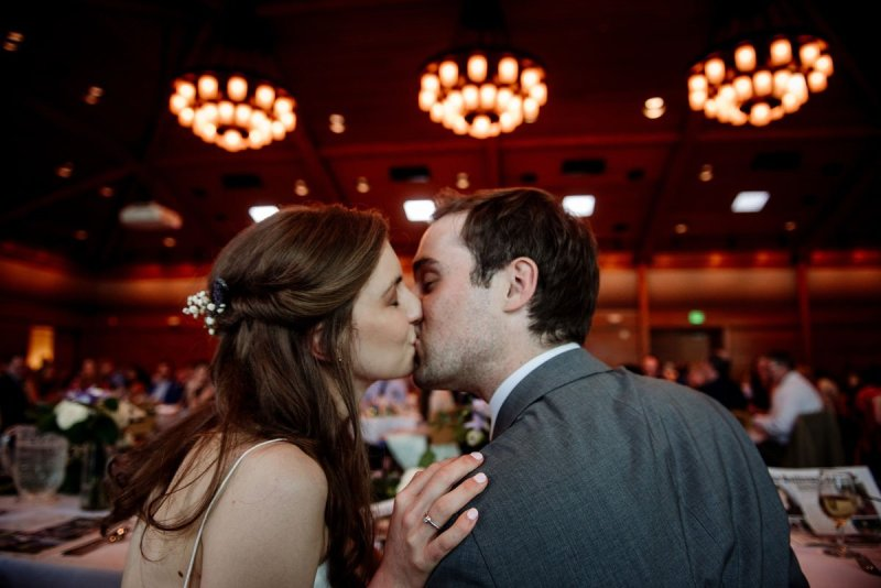 bride and groom kiss in reception silverwood park wedding mn