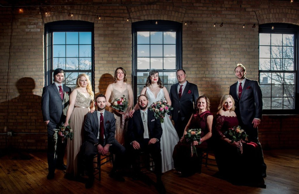 flash composite of wedding party at solar arts building in northeast minneapolis