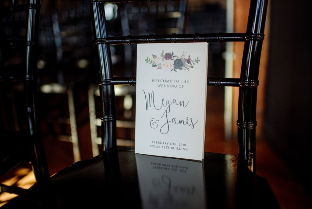 wedding program on chairs at solar arts wedding
