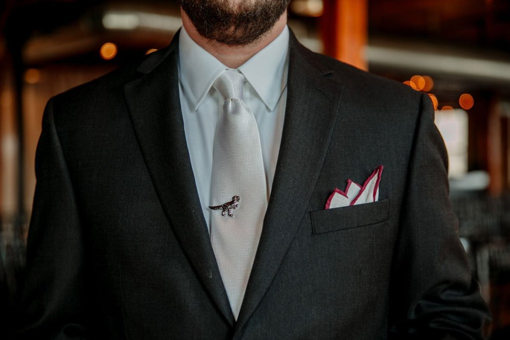 groom with dino tie clip