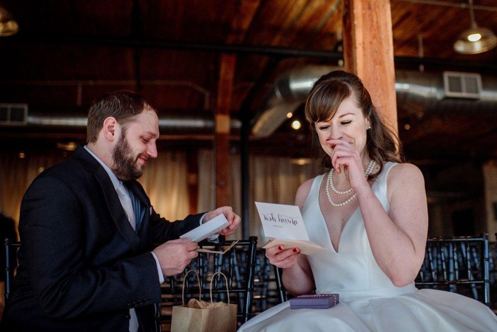 bride and groom exchange letters on wedding