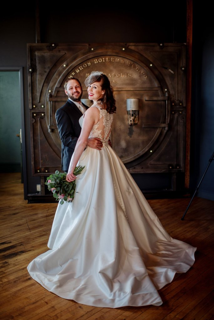 bride and groom in classic pose at solar arts