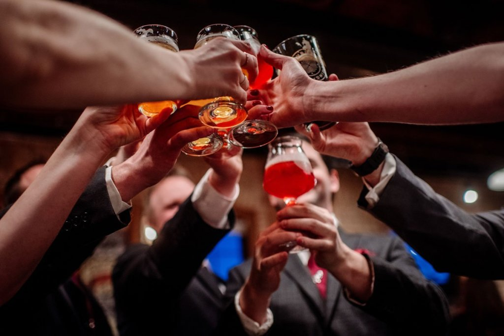 wedding party toasts with beer at indeed brewing in ne minneapolis