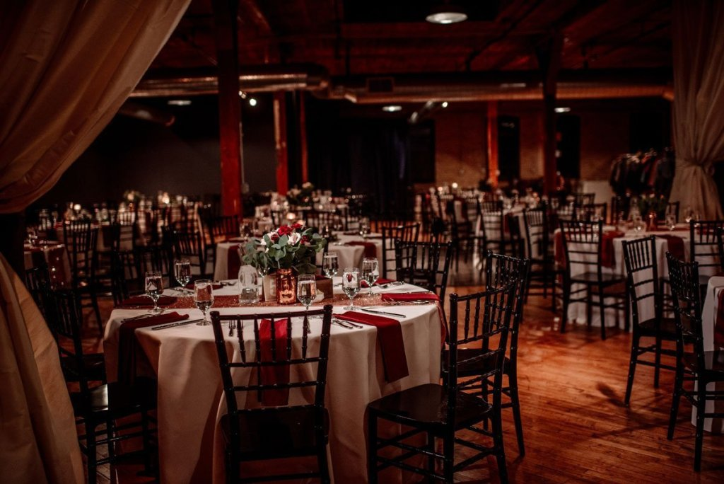 tables set for winter wedding at solar arts space