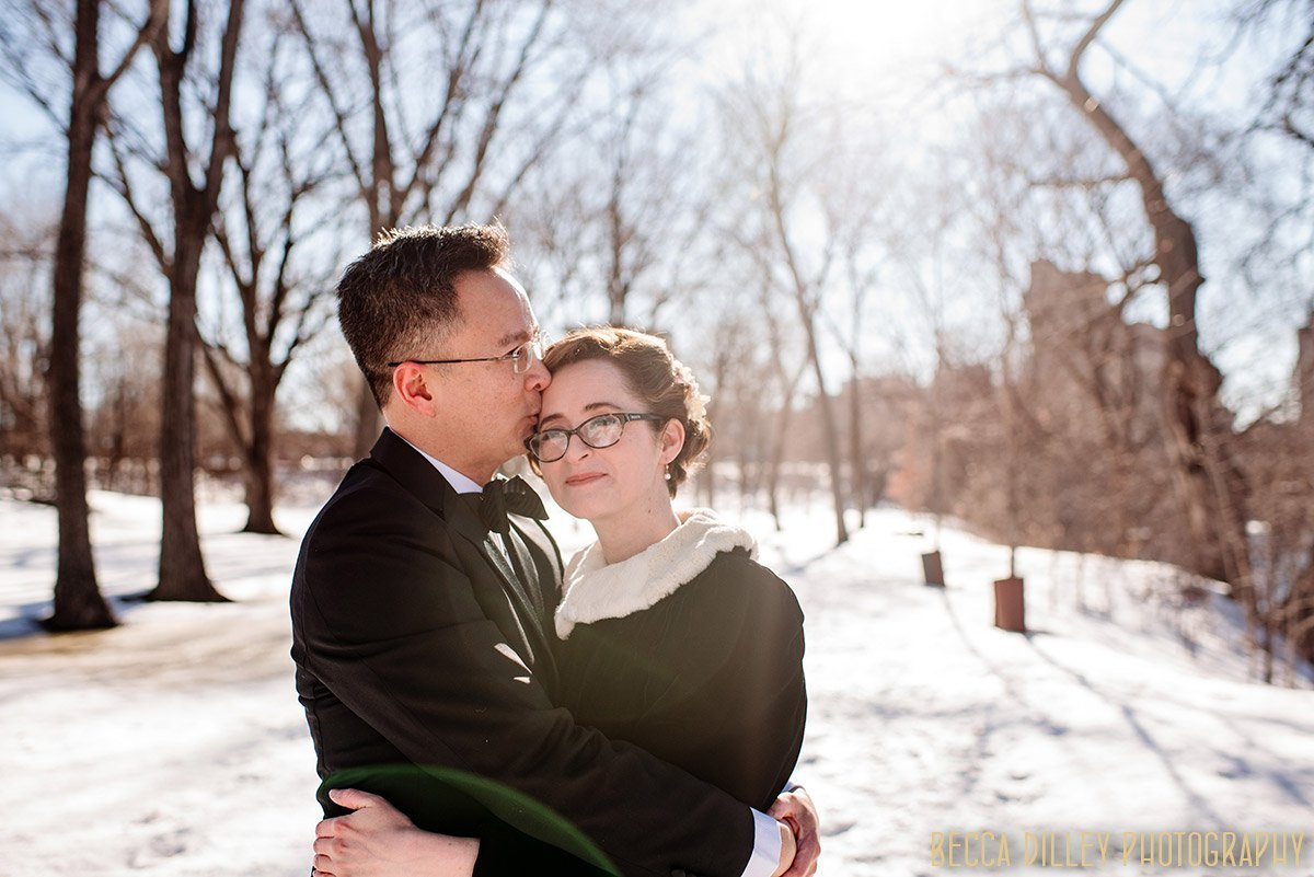 couple have adventurous elopement photos in winter in minneapolis