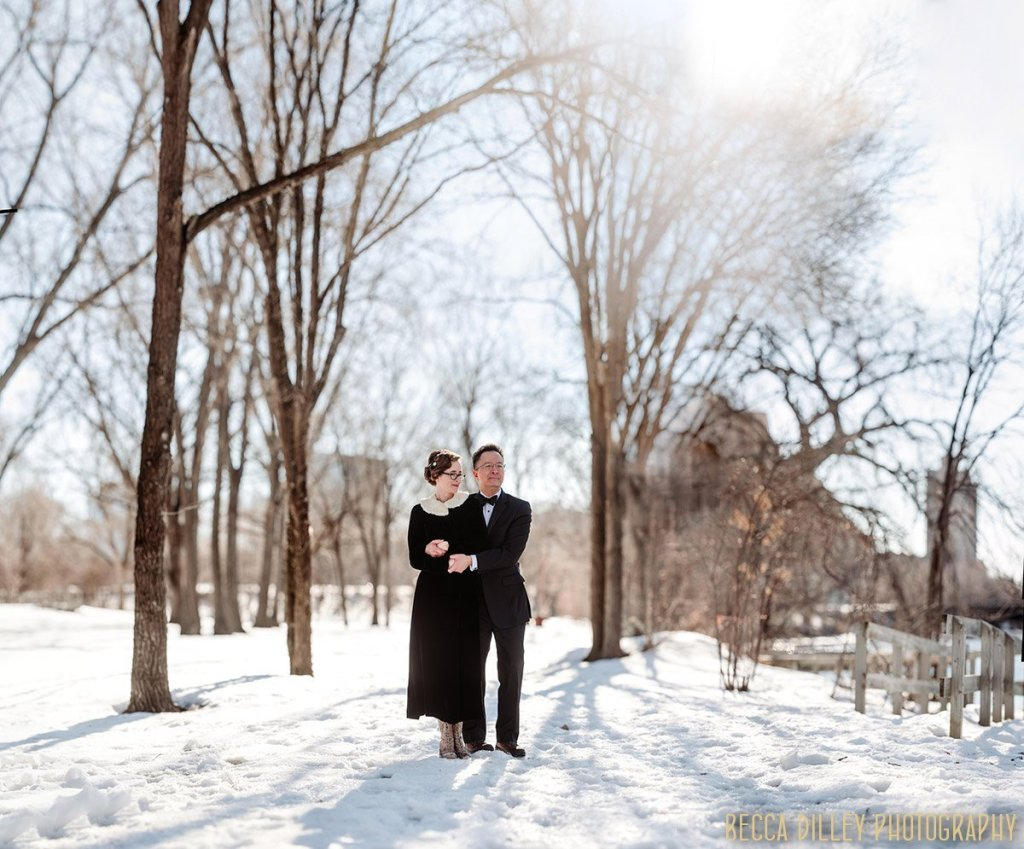 panorama of couple in winter snowy park minneapolis