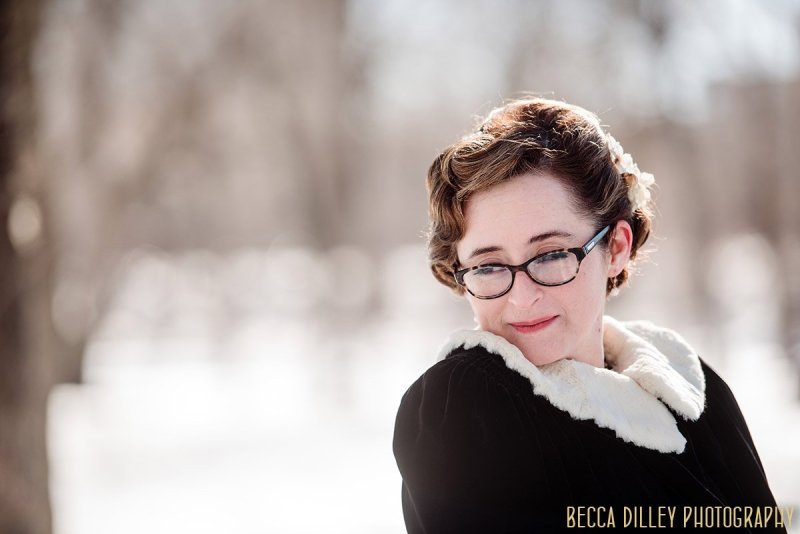 bride outside on cold winter day with fur lined coat before winter elopement minneapolis