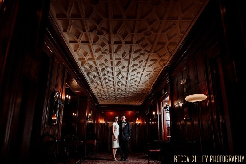 couple in minneapolis mansion with dramatic lighting showing off architectural ceiling for the elopement