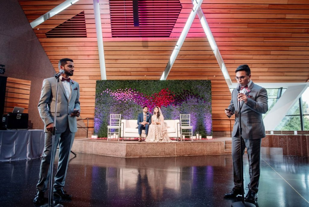 MCs for the evening give toasts mulsim pakistani wedding at McNamara Center in Minneapolis