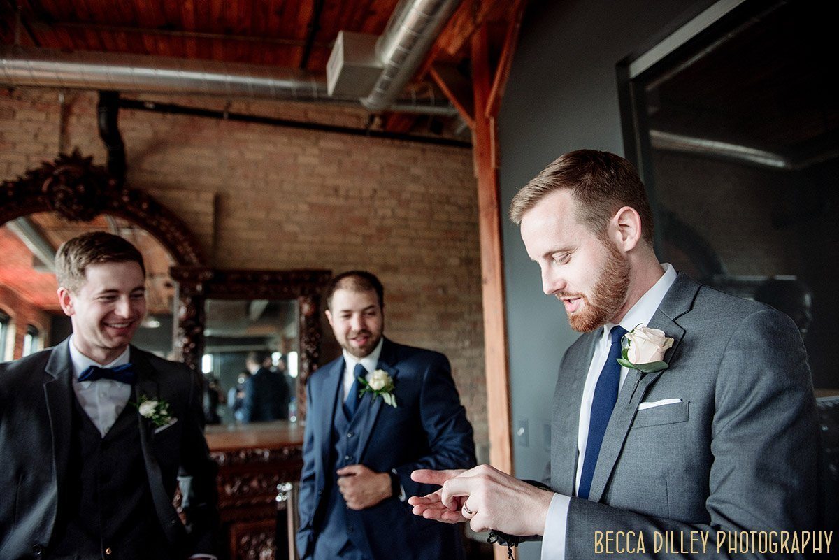 groomsmen getting ready at solar arts wedding northeast minneapolis