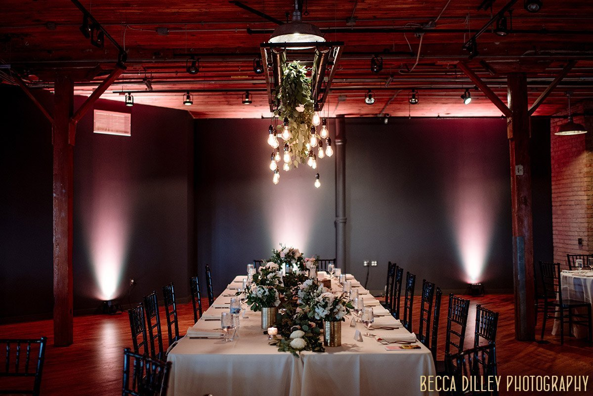 interior of solar arts wedding reception with tablesettings