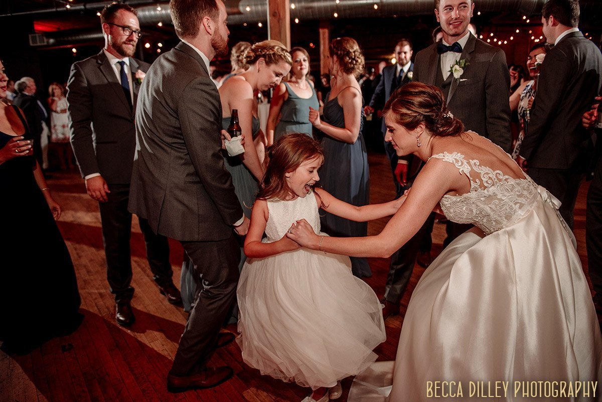 bride dances with flowergirl solar arts wedding