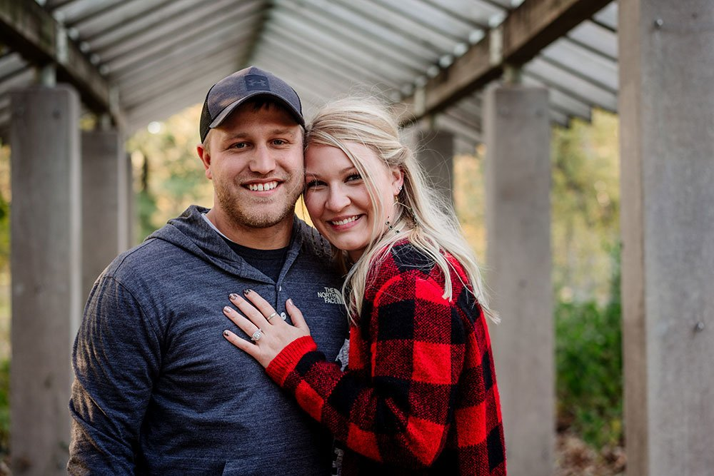 proposal at minnehaha falls minneapolis wedding photographer