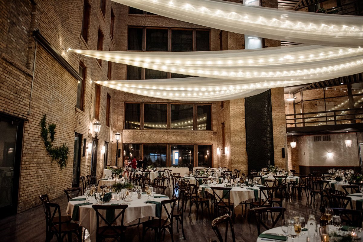 reception room is draped in lights cocktail hour at the lumber exchange minneapoils
