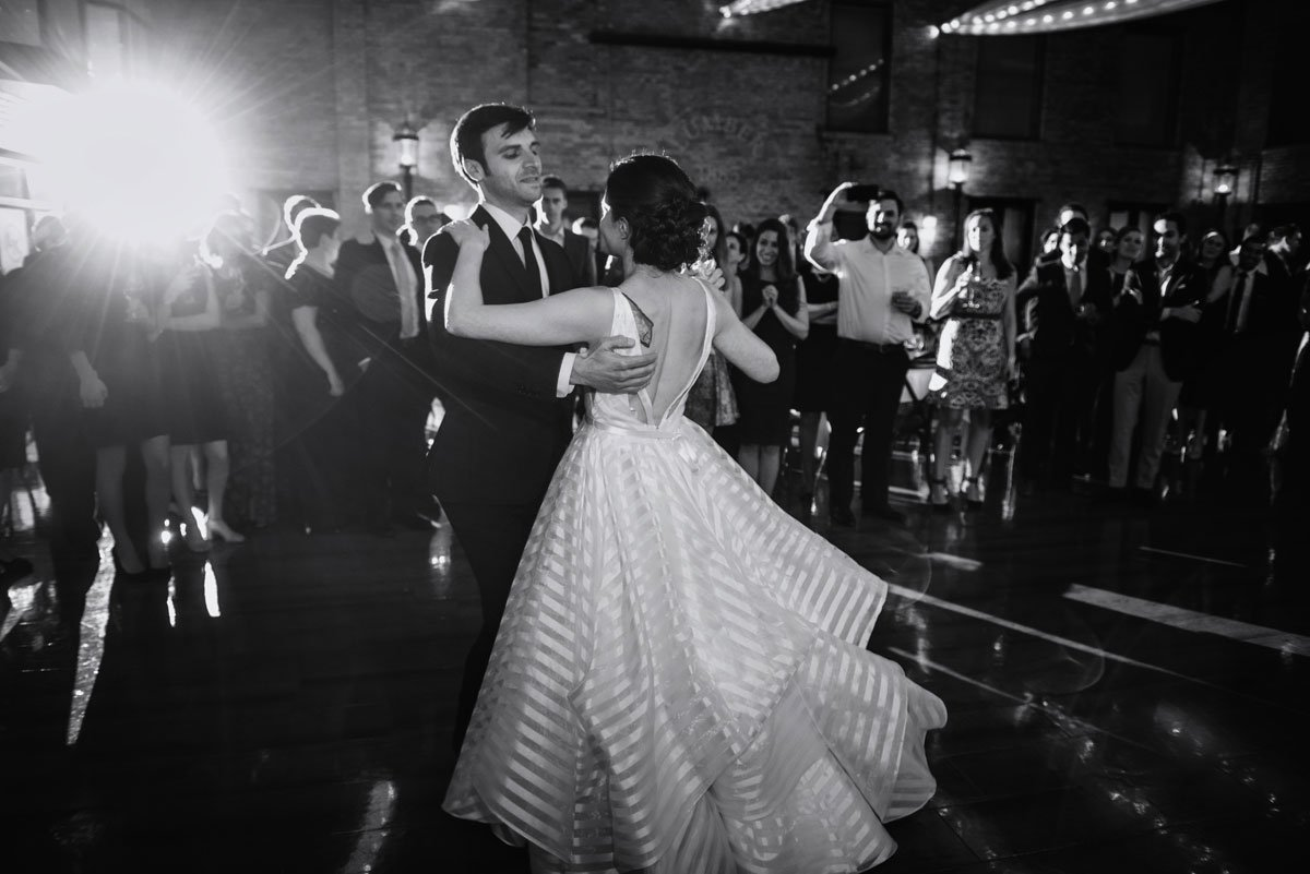 black and white photo of bride and groom dancing lumber exchange wedding minneapoils