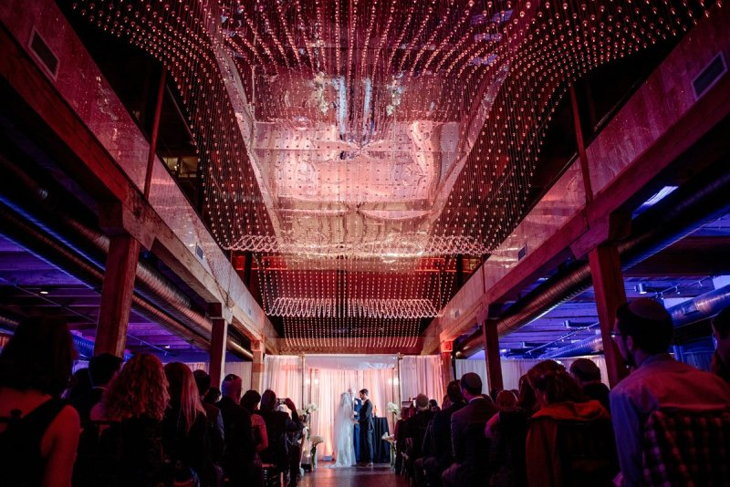 dramatic lighting for grand room ceremony at MInneapolis Event Center