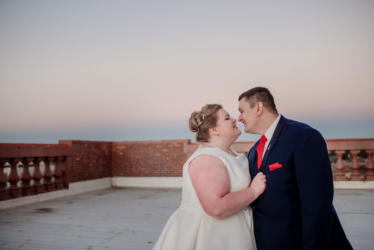 couple embrace on the roof of washington pavilion wedding sioux falls
