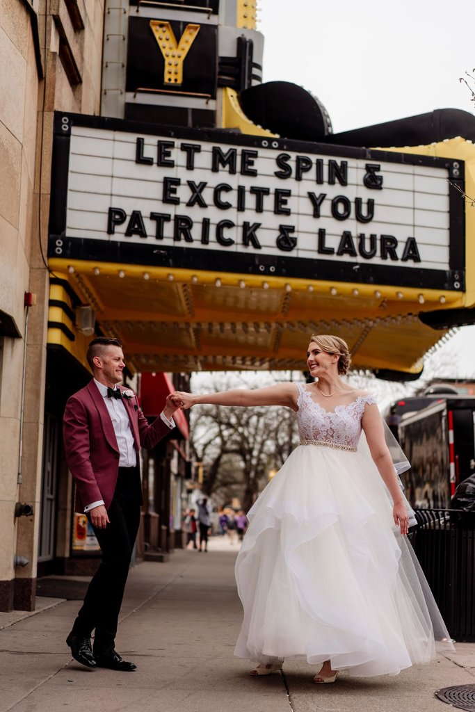 couple dance below marquee before loring restaurant wedding minneapolis