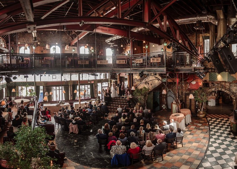 panorama of wedding ceremony inside ornate loring restaurant in dinkytown
