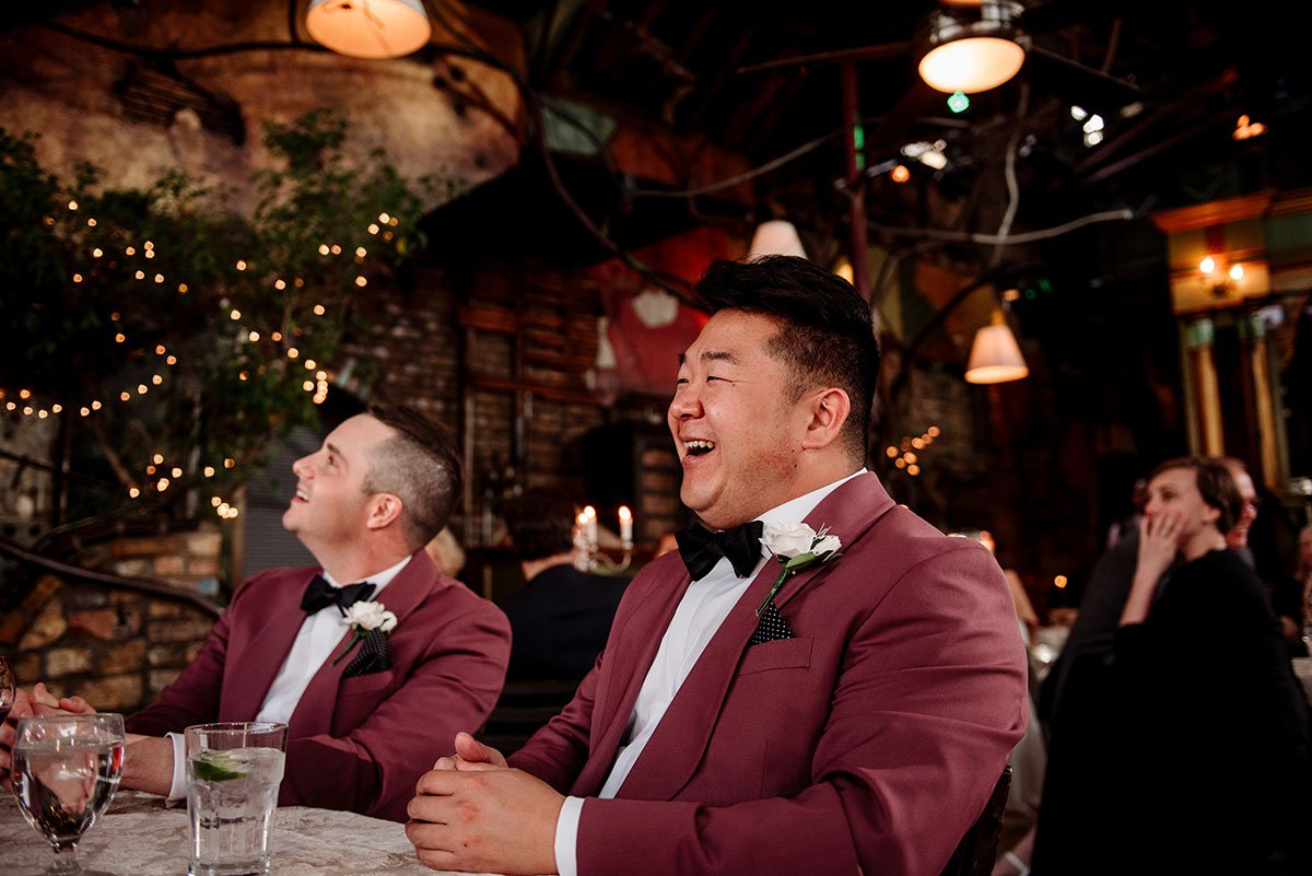 wedding party laughs during toasts at loring minneapolis