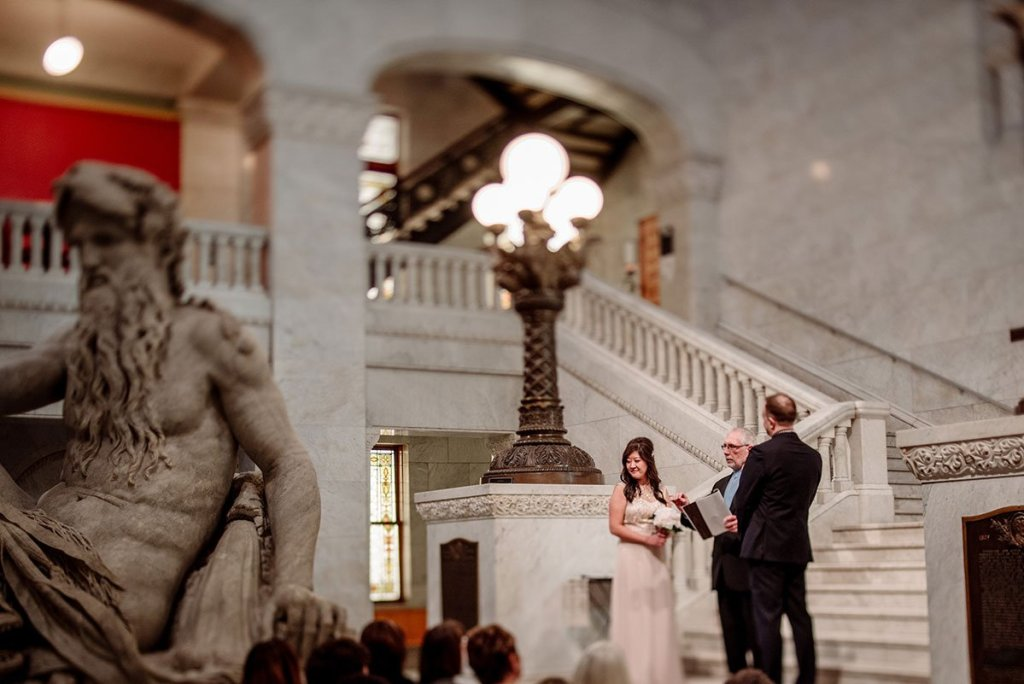 ceremony inside minneapolis city hall rotunda with tilt shift lens Minneapolis City Hall Wedding
