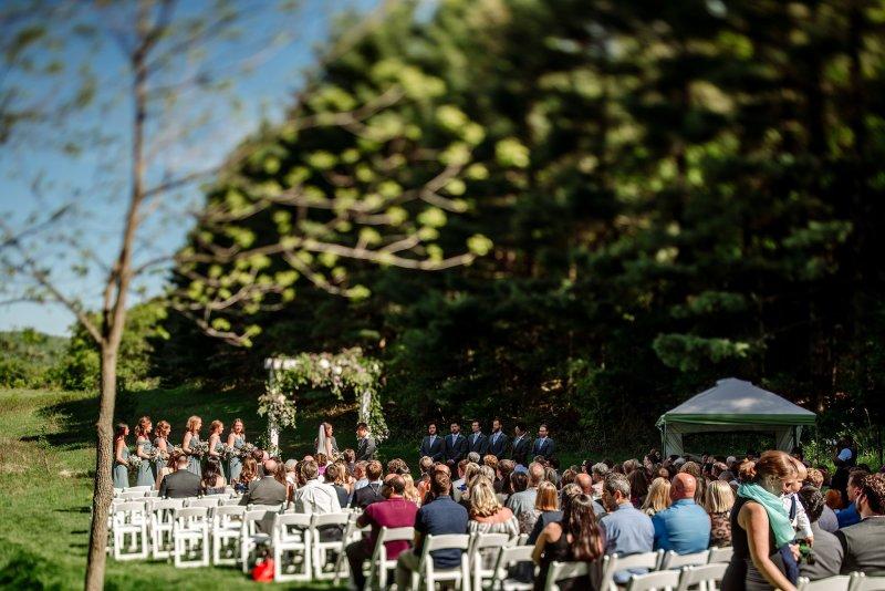 tilt shift image of wedding ceremony in mn field
