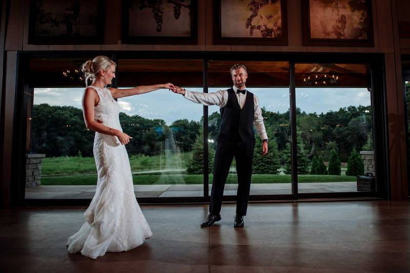 groom spins bride for first dance at 7 vines vinyard wedding mn
