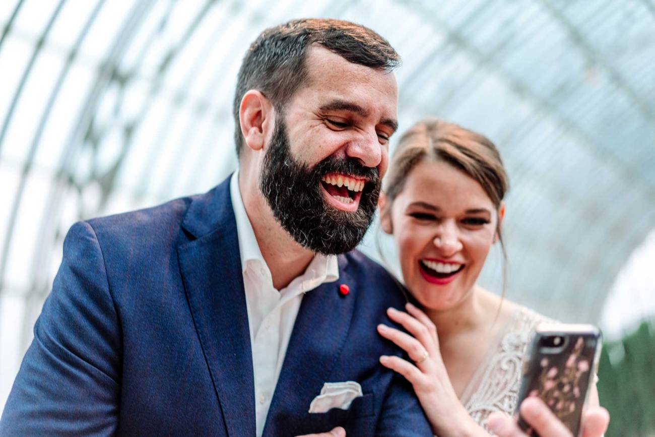 bride and groom skype with family members during small wedding ceremony Como Conservatory