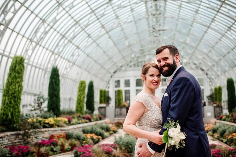 bride and groom at Como Conservatory sunken garden before wedding