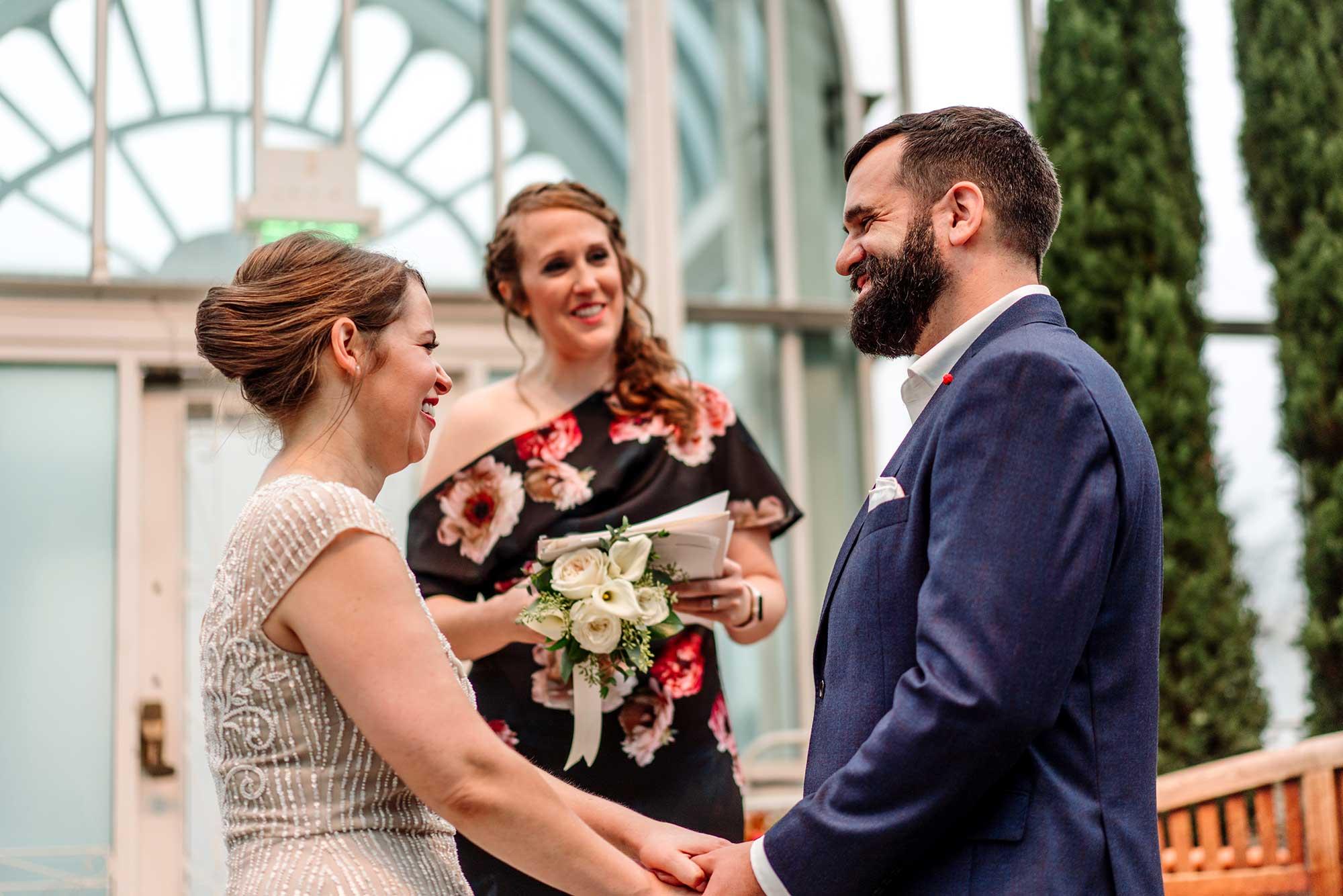 wedding ceremony inside sunken garden of Como Conservatory
