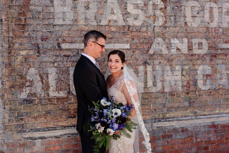 Bride and groom in warehouse district of Minneapolis before wedding at aria