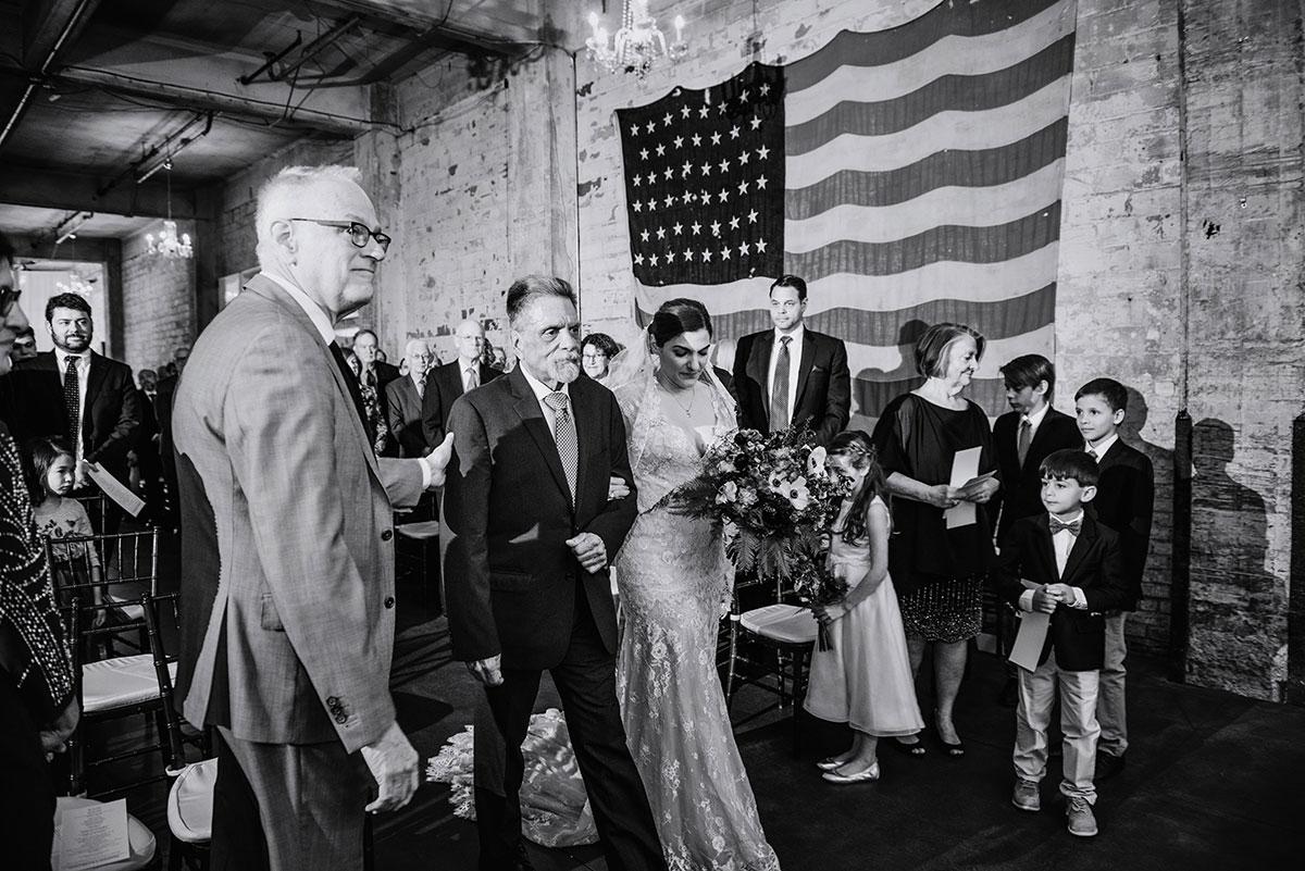 bride walks down aisle at aria wedding minneapolis