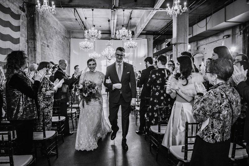 bride and groom walk down aisle at aria